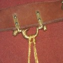 A brass purse hanger designed from a 14th century example