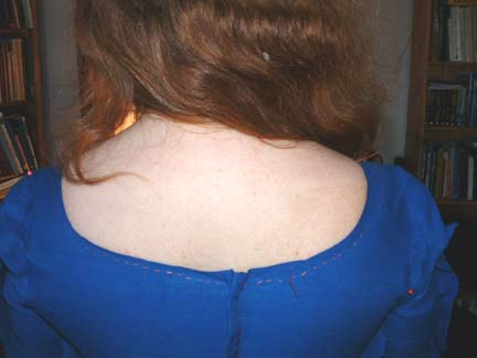 Basting the neckline to prevent stretch
