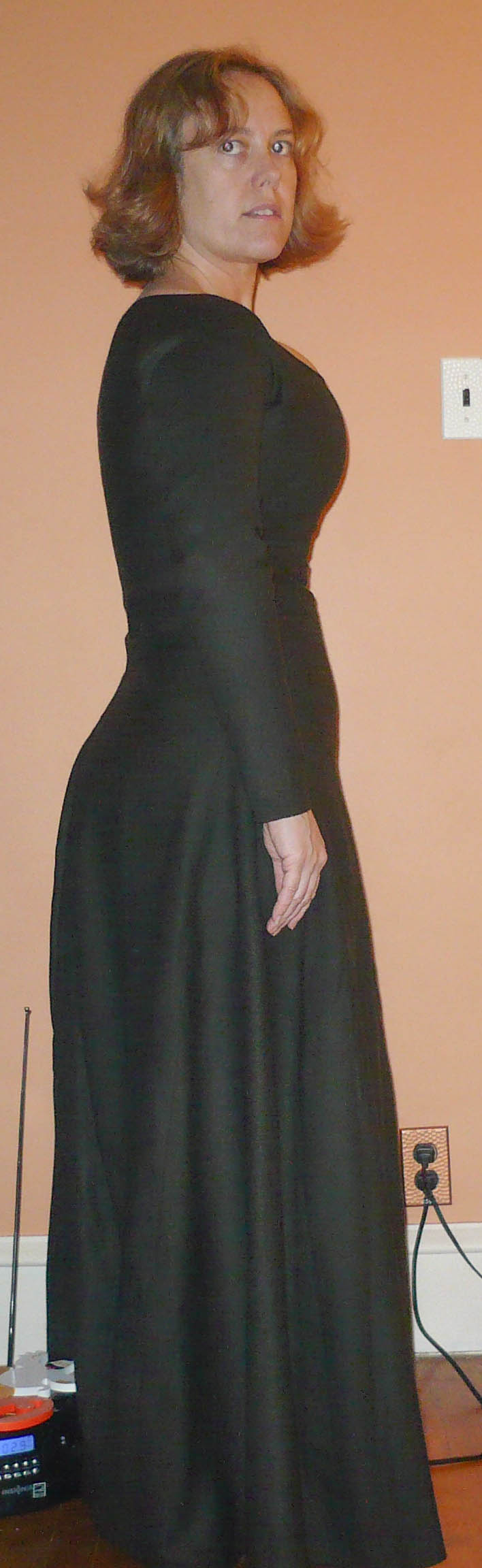 Side view of a straight front dress