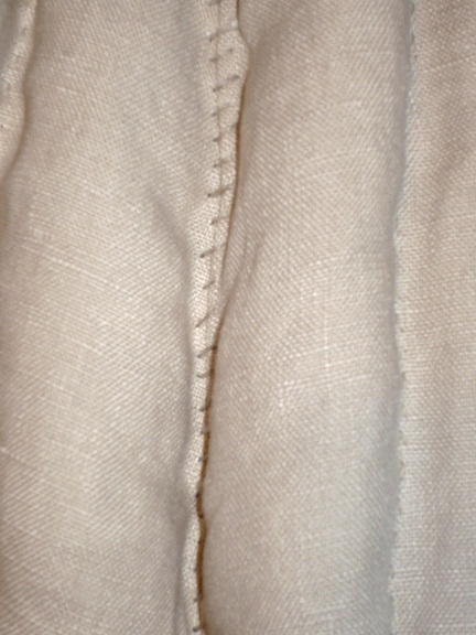 The overcast stitching on the original was as crude and obvious as that seen here. This was a brute-force stitch whose purpose was entirely practical rather than for style.