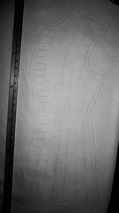 The front pattern piece with buttonhole guide and seam allowances.