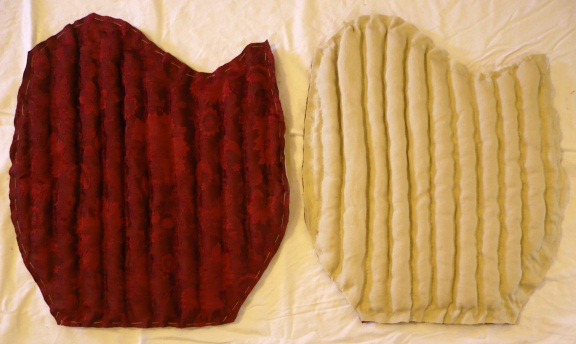 Both sleeves, cut out. One is shown outer-side-up and the other is shown lining-side-up.