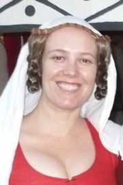 Wearing synthetic braids sewn to a table-woven band with a linen veil. Picture taken in 2012.