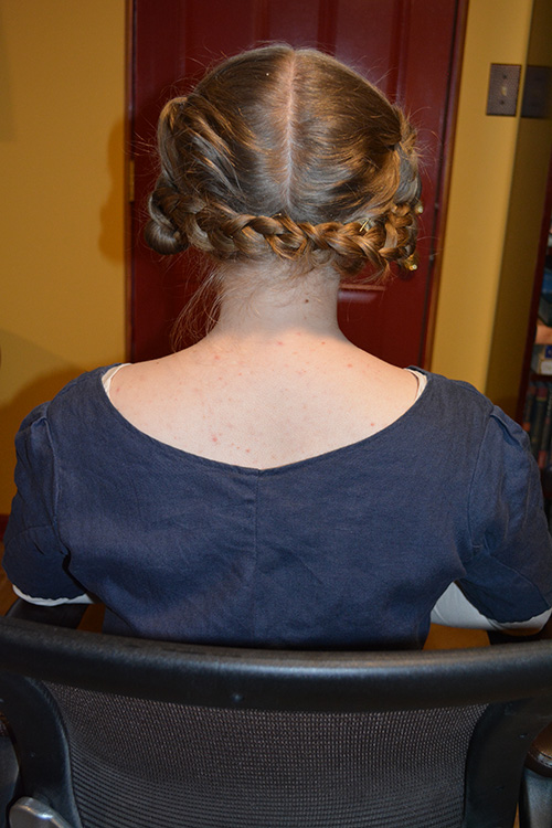 Back view of the hairstyle. Everything is secured with pins alone, and it was dicey at best. A stiff wind would have made it come tumbling down.