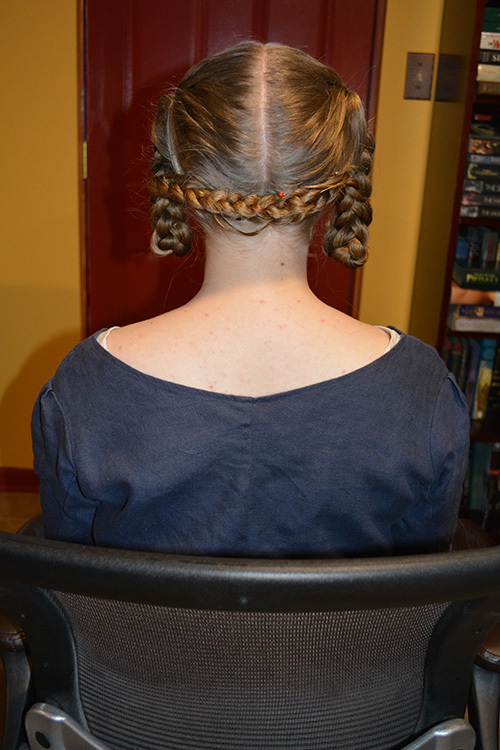 Back view of the finished hairstyle. With the gel providing some stickiness and stiffness, I have much more confidence that the pinned arrangement will not fall out over the course of a normal day's activity.