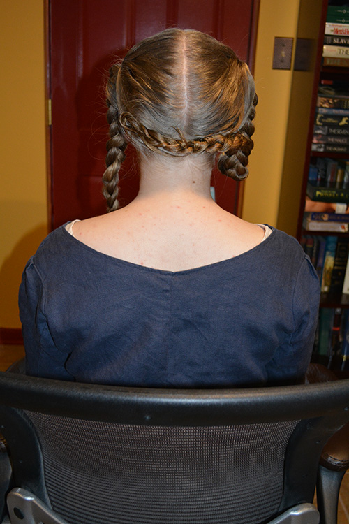With the gel, wrapping the hair and securing it on the back of the head with pins alone was an easy process.