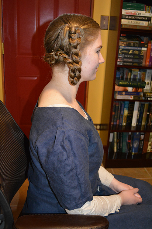 Side view of the finished hairstyle.