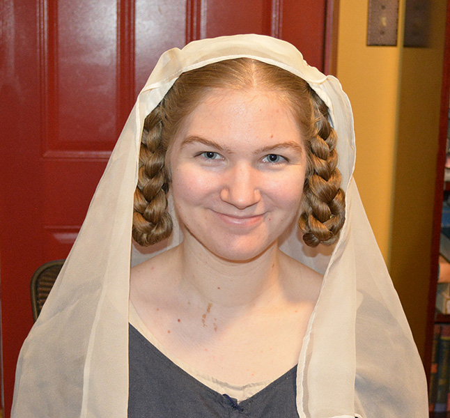 The braids look lovely when framed with a simple silk veil.