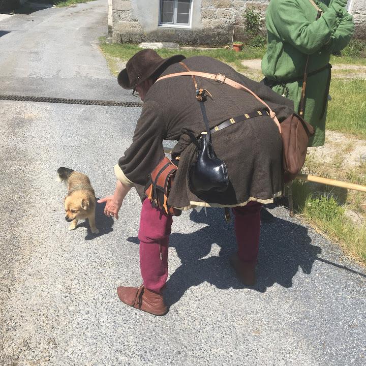 Greg prepares to fight a wild dog.