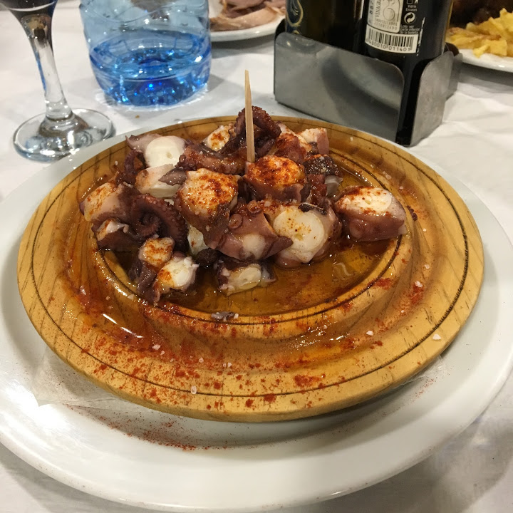 Galician octopus, which is always served on a round, wooden platter like this.