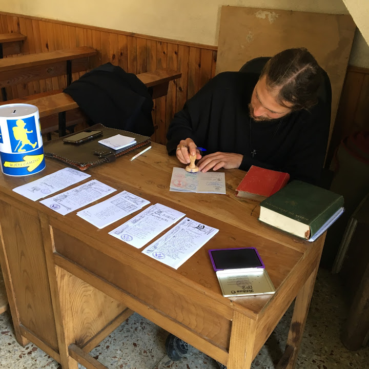 A young and handsome acolyte stamped our passports in a rural church. It was unusual to come across an open church in these remote hamlets.